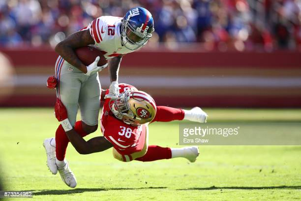 Adrian Colbert of the San Francisco 49ers tackles Tavarres King of the New York Giants during their NFL game at Levi's Stadium on November 12 2017 in...