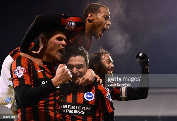 Adrian Colunga of Brighton celebrates scoring the first goal during the Sky Bet Championship match between Fulham and Brighton & Hove Albion at...