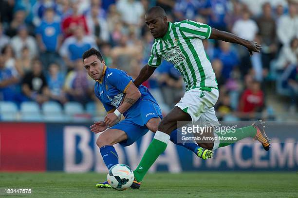 Adrian Colunga of Getafe CF competes for the ball with Paulo Alfonso Santos alias Paulao of Real Betis Balompie during the La Liga match between...