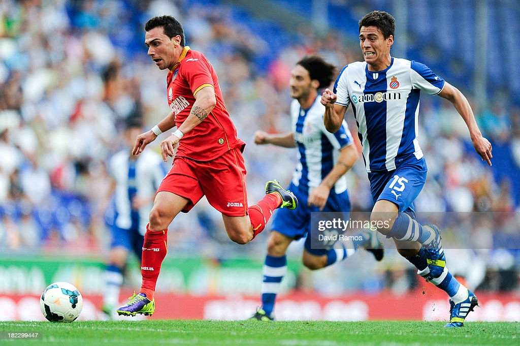 Adrian Colunga (L) of Getafe CF duels for the ball with Hector Moreno of RCD Espanyol during the La Liga match between RCD Espanyol and Getafe CF at Cornella-El Prat Stadium on September 29, 2013 in Barcelona, Spain.