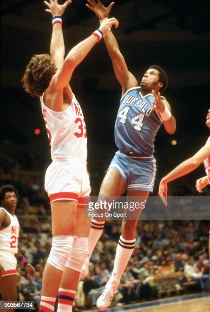 Adrian Dantley of the Buffalo Braves shoots over Kim Hughes of the New Jersey Nets during an NBA basketball game circa 1977 at the Rutgers Athletic...