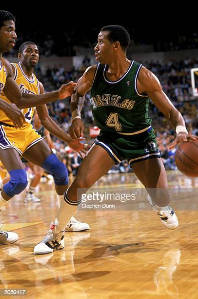 Adrian Dantley of the Dallas Mavericks drives the ball during the NBA game against the Los Angeles Lakers at the Great Western Forum in Los Angeles...