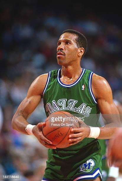 Adrian Dantley of the Dallas Mavericks prepares to shoot a free-throw against the Washington Bullets during an NBA basketball game circa 1989 at the...