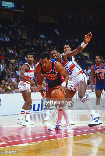 Adrian Dantley of the Detroit Pistons dribbles toward the basket against the Washington Bullets during an NBA basketball game circa 1986 at the...