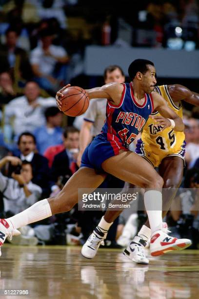 Adrian Dantley of the Detroit Pistons drives to the basket against the Los Angeles Lakers during an NBA game at the Great Western Forum in 1987 in...