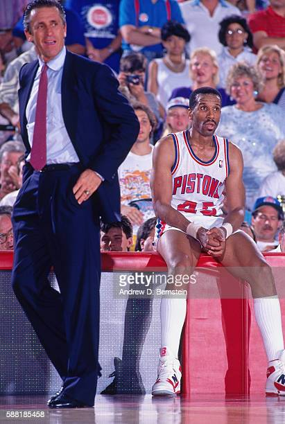 Adrian Dantley of the Detroit Pistons looks on from the sideline during a game against the Los Angeles Lakers circa 1988 at The Palace of Auburn...
