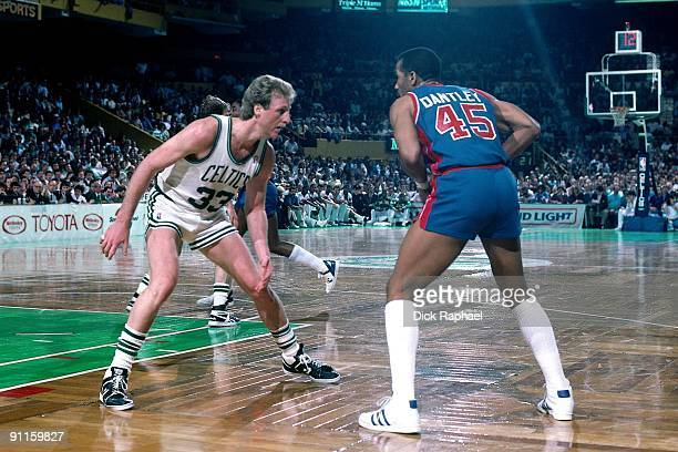 Adrian Dantley of the Detroit Pistons looks to make a move against Larry Bird of the Boston Celtics during a game played in 1987 at the Boston Garden...