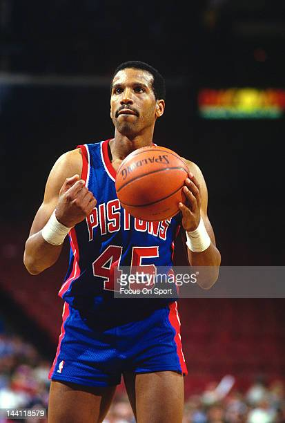 Adrian Dantley of the Detroit Pistons sets to shoot a free-throw against the Philadelphia 76ers during an NBA basketball game circa 1986 at The...