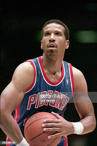 Adrian Dantley of the Detroit Pistons shoots a foul shot during a game against the Boston Celtics at the Boston Garden in Boston Massachusetts circa...