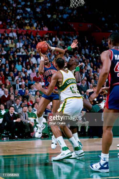 Adrian Dantley of the Detroit Pistons shoots against Alton Lister of the Detroit Pistons at the Seattle Coliseum in Seattle Washington circa 1988...