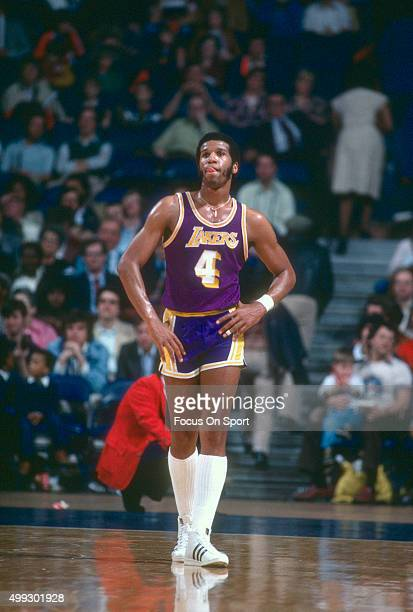 Adrian Dantley of the Los Angeles Lakers looks on against the Washington Bullets during an NBA basketball game circa 1978 at the Capital Centre in...