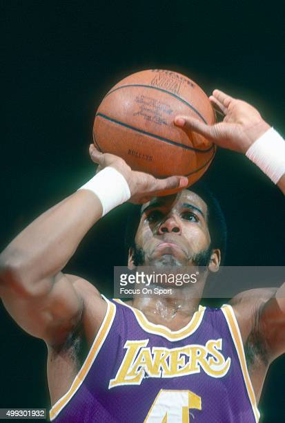 Adrian Dantley of the Los Angeles Lakers shoots a free throw against the Washington Bullets during an NBA basketball game circa 1978 at the Capital...