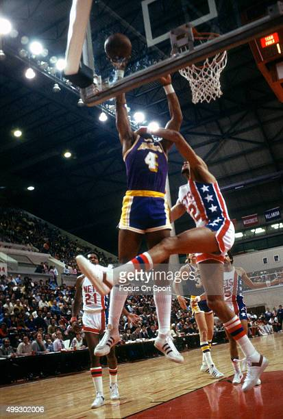 Adrian Dantley of the Los Angeles Lakers shoots against the New Jersey Nets during an NBA basketball game circa 1979 at the Rutgers Athletic Center...