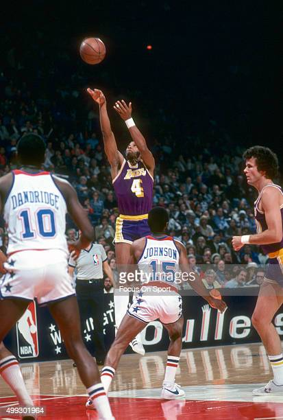 Adrian Dantley of the Los Angeles Lakers shoots over Charles Johnson of the Washington Bullets during an NBA basketball game circa 1978 at the...
