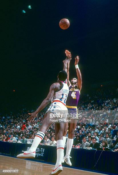 Adrian Dantley of the Los Angeles Lakers shoots over Elvin Hayes of the Washington Bullets during an NBA basketball game circa 1978 at the Capital...