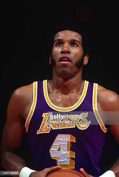 Adrian Dantley of the Los Angeles Lakers stand at the freethrow line looking to shoot against the Washington Bullets during an NBA basketball game...