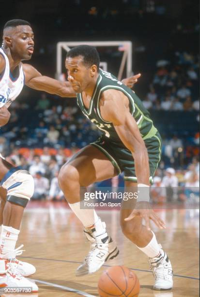 Adrian Dantley of the Milwaukee Bucks dribbles the ball against the Washington Bullets during an NBA basketball game circa 1991 at the Capital Centre...
