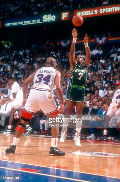Adrian Dantley of the Milwaukee Bucks takes the jump shot over Charles Barkley of the Philadelphia 76ers during Game 3 of the NBA Eastern Division...