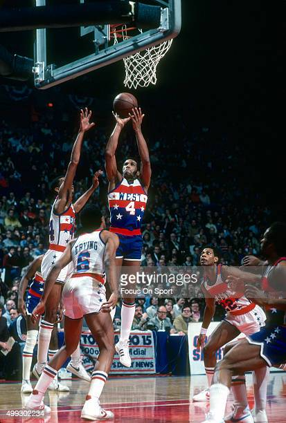 Adrian Dantley of the Utah Jazz and the West All Stars shoots over George Gervin and Julius Erving of the East All Stars during the NBA All Star Game...