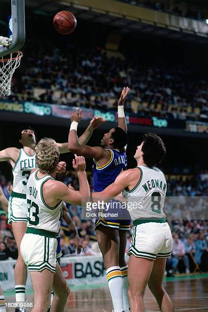 Adrian Dantley of the Utah Jazz defended by Kevin McHale of the Boston Celtics shoots during a game circa 1986 at the Boston Garden in Boston...