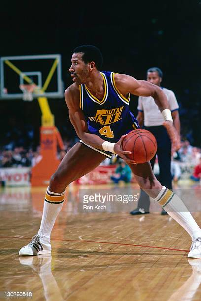 Adrian Dantley of the Utah Jazz dribbles against the Los Angeles Lakers during a game played circa 1987 at the Great Western Forum in Inglewood...