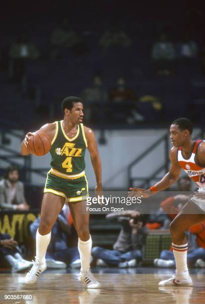 Adrian Dantley of the Utah Jazz dribbles the ball against the Washington Bullets during an NBA basketball game circa 1982 at the Capital Centre in...
