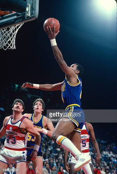 Adrian Dantley of the Utah Jazz goes in to lay the ball up against the Washington Bullets during an NBA basketball game circa 1984 at the Capital...
