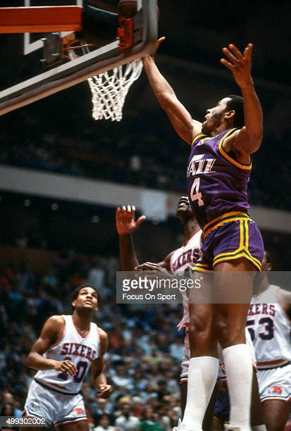 Adrian Dantley of the Utah Jazz goes up to shoot against the Philadelphia 76ers during an NBA basketball game circa 1980 at The Spectrum in...