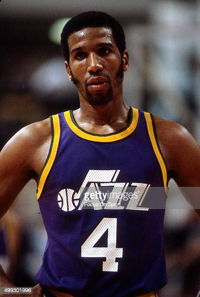 Adrian Dantley of the Utah Jazz looks on against the New Jersey Nets during an NBA basketball game circa 1980 at the Rutgers Athletic Center in...