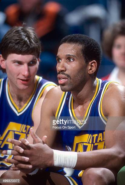 Adrian Dantley of the Utah Jazz looks on from the bench against the Washington Bullets during an NBA basketball game circa 1984 at the Capital Centre...
