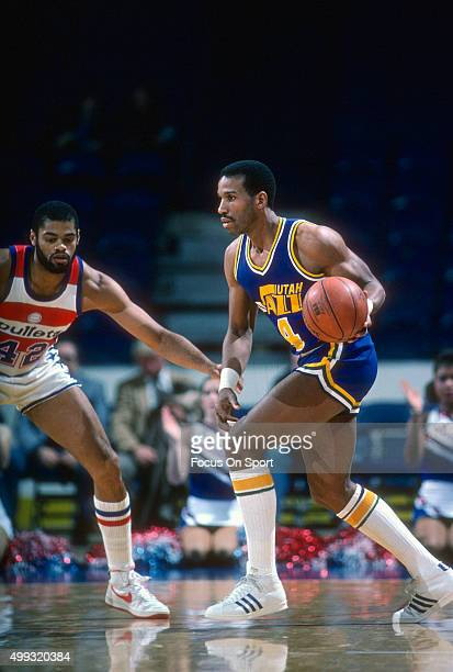 Adrian Dantley of the Utah Jazz looks to dribble past Greg Ballard of the Washington Bullets during an NBA basketball game circa 1984 at the Capital...