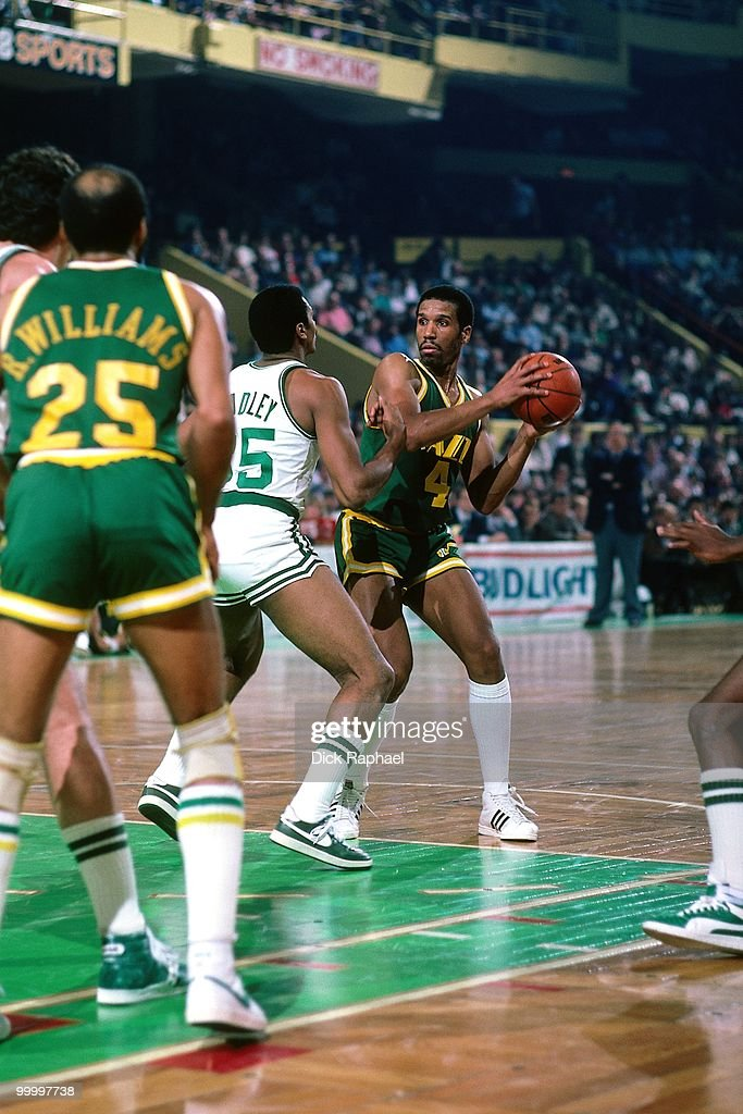 Adrian Dantley #4 of the Utah Jazz looks to make a move against Charles Bradley #35 of the Boston Celtics during a game played in 1983 at the Boston Garden in Boston, Massachusetts.