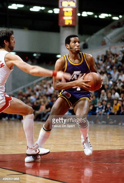 Adrian Dantley of the Utah Jazz looks to shoot against the New Jersey Nets during an NBA basketball game circa 1980 at the Rutgers Athletic Center in...