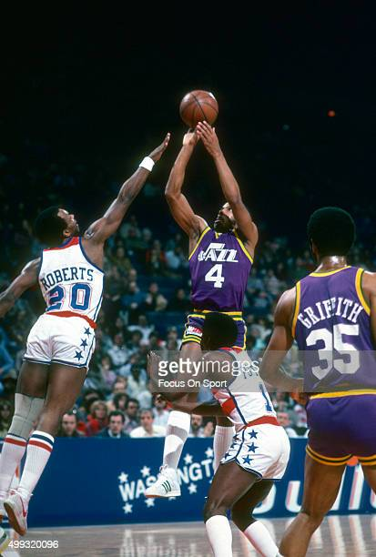 Adrian Dantley of the Utah Jazz looks to shoot over Anthony Roberts of the Washington Bullets during an NBA basketball game circa 1980 at the Capital...