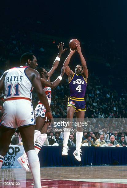 Adrian Dantley of the Utah Jazz looks to shoot over Don Collins of the Washington Bullets during an NBA basketball game circa 1980 at the Capital...