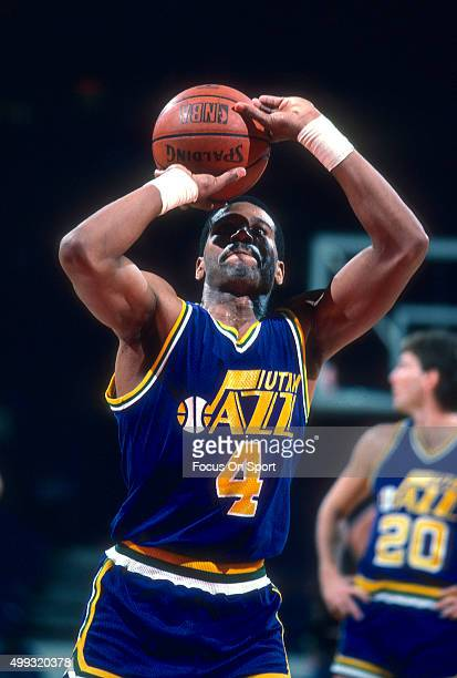Adrian Dantley of the Utah Jazz shoots a free throw against the Washington Bullets during an NBA basketball game circa 1984 at the Capital Centre in...