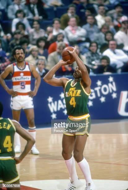 Adrian Dantley of the Utah Jazz shoots a free throw against the Washington Bullets during an NBA basketball game circa 1982 at the Capital Centre in...