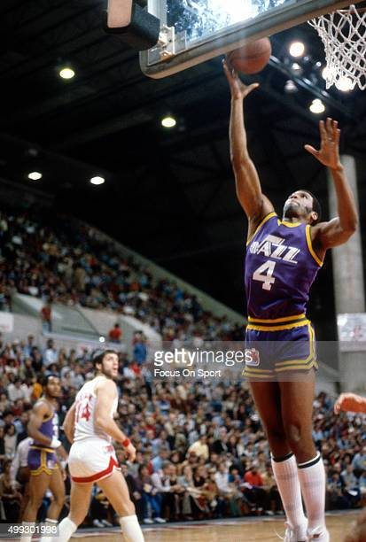 Adrian Dantley of the Utah Jazz shoots against the New Jersey Nets during an NBA basketball game circa 1980 at the Rutgers Athletic Center in...