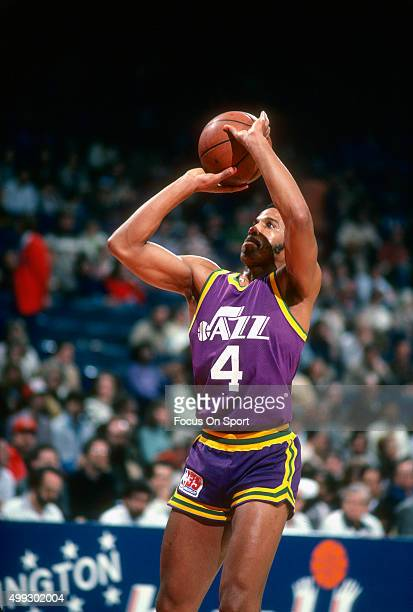 Adrian Dantley of the Utah Jazz shoots against the Washington Bullets during an NBA basketball game circa 1980 at the Capital Centre in Landover...