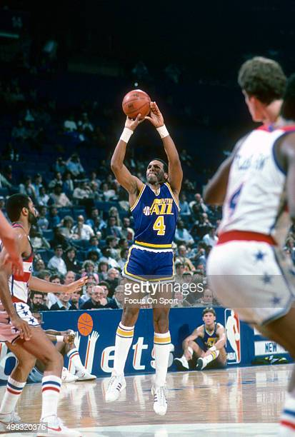 Adrian Dantley of the Utah Jazz shoots against the Washington Bullets during an NBA basketball game circa 1984 at the Capital Centre in Landover...