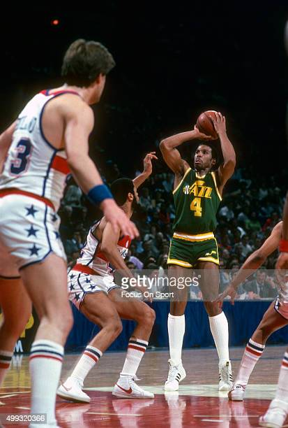 Adrian Dantley of the Utah Jazz shoots over Greg Ballard of the Washington Bullets during an NBA basketball game circa 1982 at the Capital Centre in...