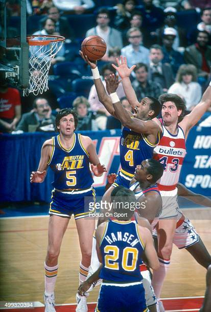 Adrian Dantley of the Utah Jazz shoots over Jeff Ruland of the Washington Bullets during an NBA basketball game circa 1984 at the Capital Centre in...