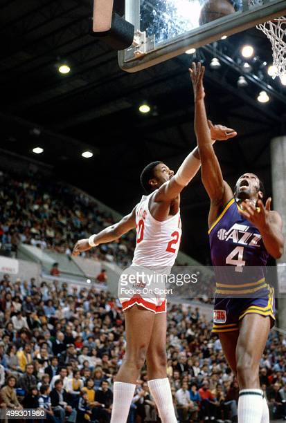 Adrian Dantley of the Utah Jazz shoots over Maurice Lucas of the New Jersey Nets during an NBA basketball game circa 1980 at the Rutgers Athletic...