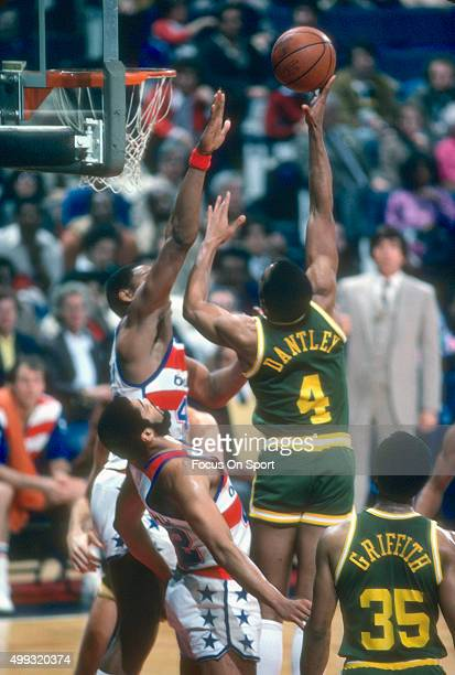 Adrian Dantley of the Utah Jazz shoots over Rick Mahorn of the Washington Bullets during an NBA basketball game circa 1982 at the Capital Centre in...