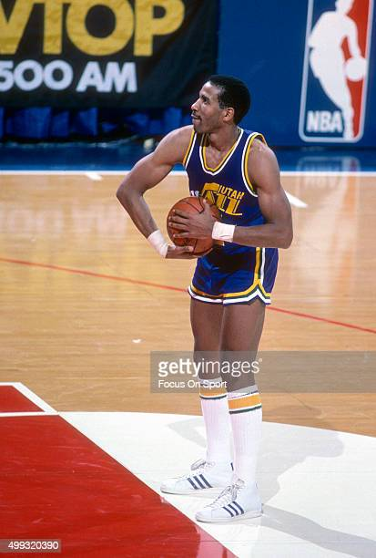 Adrian Dantley of the Utah Jazz stands at the line to shoot a free throw against the Washington Bullets during an NBA basketball game circa 1984 at...