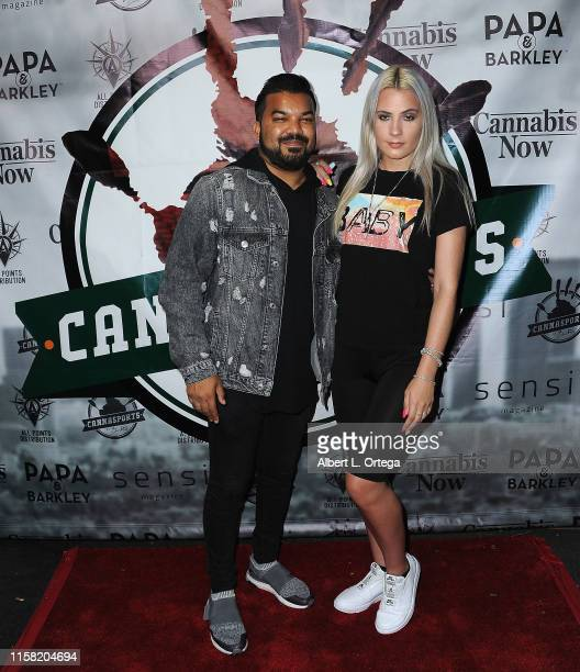 Adrian Dev and Kristi Tucker attend Gary Payton's Cannasports Launch Party held at LA Liason on July 27 2019 in Los Angeles California
