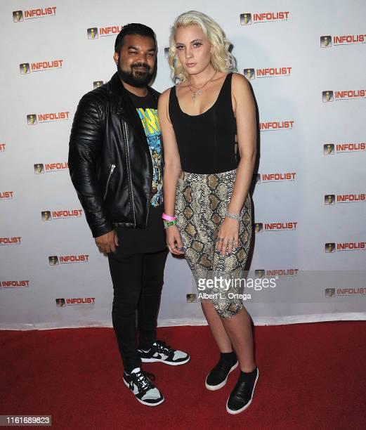 Adrian Dev and Kristi Tucker attend InfoListcom's PreComicCon Bash held at Wisdome Immersive Art Park on July 11 2019 in Los Angeles California