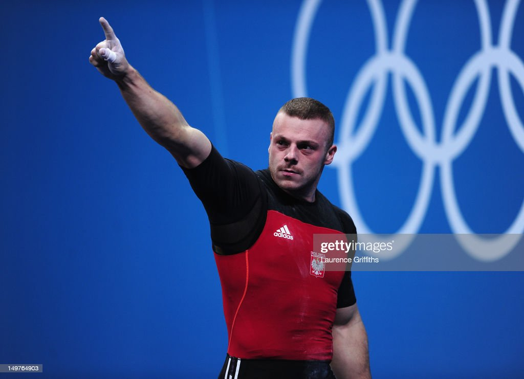 Adrian Edward Zielinski of Poland celebrates on his way to winning the Gold medal during the Men's 85kg Weightlifting Final on Day 7 of the London 2012 Olympic Games at ExCeL on August 3, 2012 in London, England.