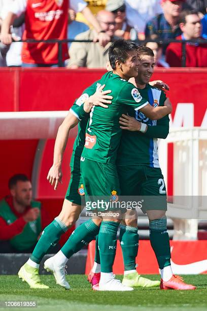 Adrian Embarba of RCD Espanyol celebrates scoring his team's opening goal with Wu Lei during the Liga match between Sevilla FC and RCD Espanyol at...