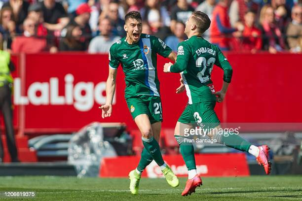Adrian Embarba of RCD Espanyol celebrates scoring his team's opening goal with Marc Roca during the Liga match between Sevilla FC and RCD Espanyol at...